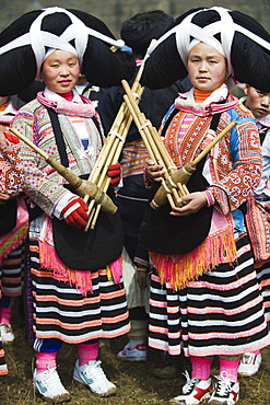 Long Horn Miao women at lunar New Year festival celebrations in Sugao ethnic village, Guizhou Province, China, Asia