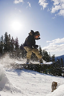 A snowboarder jumping at Whistler mountain resort, venue of the 2010 Winter Olympic Games, British Columbia, Canada, North America