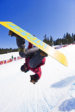 A snowboarder jumping at Telus Half Pipe competition 2009, Whistler mountain, 2010 Winter Olympics venue, British Columbia, Canada, North America