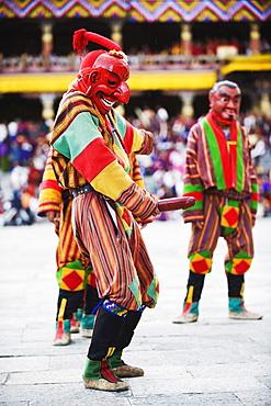 Dancer holding wooden penis, Autumn Tsechu (festival) at Trashi Chhoe Dzong, Thimpu, Bhutan, Asia