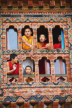 Young monks at a window, Chimi Lhakhang dating from 1499, Temple of the Divine Madman Lama Drukpa Kunley, Punakha, Bhutan, Asia