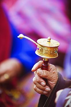 Prayer wheels being spun by a pilgrims at the National Memorial Chorten, Thimphu, Bhutan, Asia