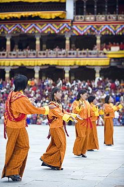 Dancers in traditional costume, Autumn Tsechu (festival) at Trashi Chhoe Dzong, Thimpu, Bhutan, Asia