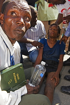 Girl being exorcised in Voodoo ritual, memorial day celebration one month after the January 2010 earthquake, Port au Prince, Haiti, West Indies, Caribbean, Central America