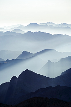 Mountains silhouetted at sunrise, view from Pico de Aneto, at 3404m the highest peak in the Pyrenees, Spain, Europe - 733-4628