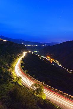 Car lights on mountain road, Lori Province, Armenia, Caucasus, Central Asia, Asia