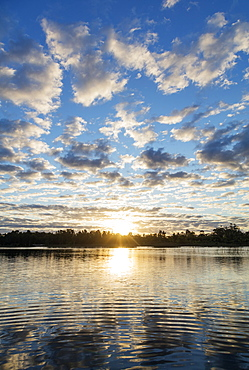 Clouds at sunset, Pangalanes Lakes canal system, Tamatave, Madagascar, Africa