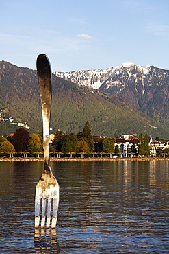 Giant fork sculpture from Alimentarium food museum, Lake Geneva (Lac Leman), Vevey, Vaud, Switzerland, Europe