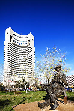 University Square, statue of a man reading a newspaper infront of Intercontinental Hotel, Bucharest, Romania, Europe