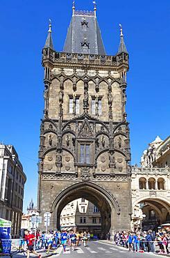 Prague Marathon runners come through the Powder Tower, Prague, UNESCO World Heritage Site, Bohemia, Czech Republic, Europe