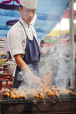 BBQ chicken cook on the street, Pokhara, Nepal, Asia