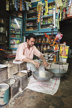 Local rural shopkeeper, Saijpur Ras, Gujarat, India, Asia