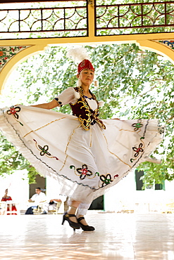 An Uyghur dancer performing dance in Abakh Hoja Tomb, Kashgar, Xinjiang Uyghur autonomy district, Silkroad, China