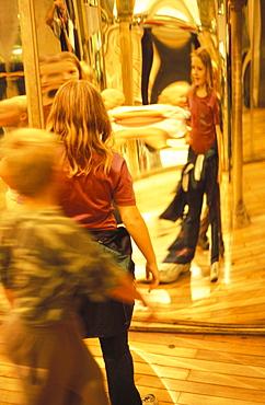 Children standing in front of distorting mirrors, in Bludiste (Maze), Petrin Gardens, Prague, Czech Republic, Europe