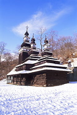 Snow-coverd Christian Orthodox wooden church of St. Michael dating from the 18th century, transferred to present site from western Ukraine village of Medvedov, Smichov, Prague, Czech Republic, Europe