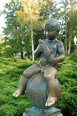 Statue of well-known boy holding a fish at spa Park of Solni and Lucni Spring in the spa town of Frantiskovy Lazne, Karlovarsky Region, West Bohemia, Czech Republic, Europe