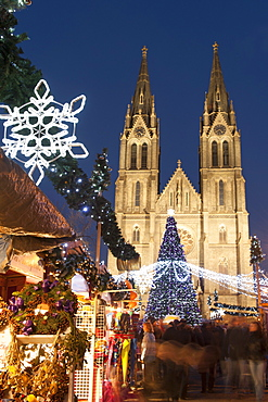 Christmas market and neo-gothic Church of St. Ludmila, Mir Square, Prague, Czech Republic, Europe