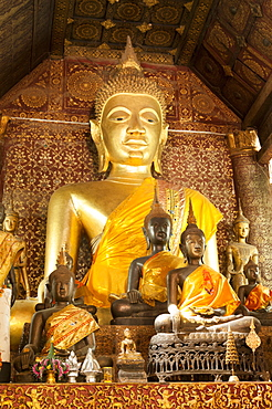 Various statues of Budhhas around altar inside Temple Wat Xiengmouane Vajiramangalaram, Luang Prabang, Laos, Indochina, Southeast Asia, Asia