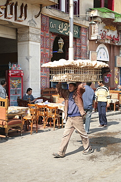 Man carrying bread, Alazhar Square, Cairo, Egypt, North Africa, Africa