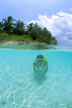 Woman snorkelling, North Male Atoll, Maldives, Indian Ocean, Asia