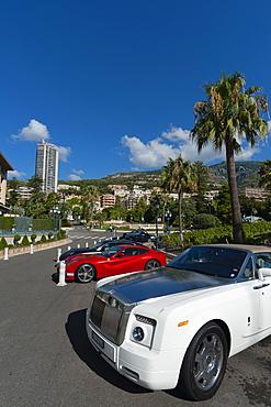 Cars parked in front of Hotel de Paris, Place du Casino, Monte Carlo, Principlity of Monaco, Europe