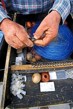 Fisherman at work, Livorno, Tuscany, Italy