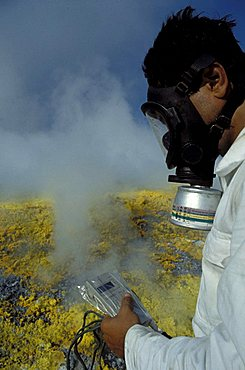 Researcher is measuring the gas temperature on the crater, CNR volcanology research, Aeolian Islands, Sicily, Italy