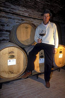 The Barolo grower G. Viberti in his wine vault, Cuneo, Piedmont, Italy.