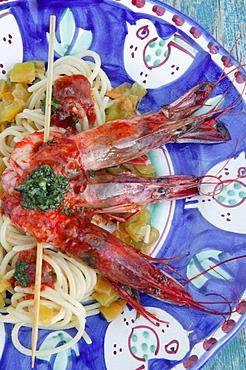 Spaghetti alla Chitarra pasta with big crawfishes and sea urchins, Orestorante restaurant, Ponza island, Lazio, Italy