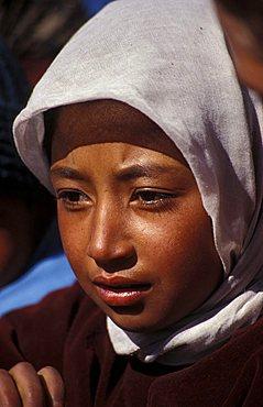Girl praying at gompa, Leh, Ladakh, India, Asia