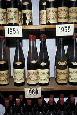 Bottles of wine, Barbi Colombini Cinelli cellar, Montalcino, Tuscany, Italy