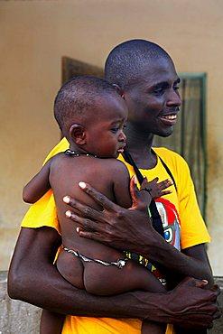 Man with child, M'Bour, Republic of Senegal, Africa