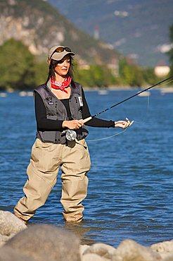 Trentino Alto Adige, Italy, Europe Fishingwoman, flyfihing, Adige river,