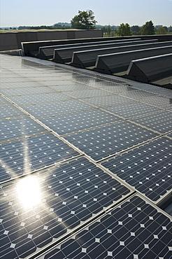 solar power system on factory, azzano san paolo, italy