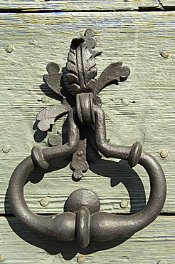 leaf on door, cerete basso, italy