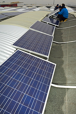 solar power system on factory roof, mapello, italy
