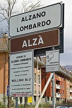 bilingual road signal, alzano lombardo, italy