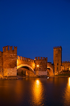 Scaligero bridge or Ponte Vecchio bridge over the Adige river near Castelvecchio castle by night,  Verona, Veneto, Italy, Europe