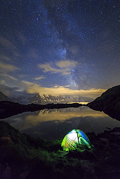 Camping under the stars and Milky Way on the shores of Lac de Cheserys Chamonix, Haute Savoie, France, Europe