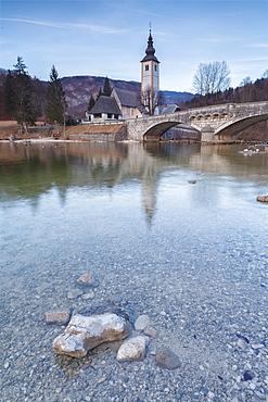 Church of Sv. John the Baptist and the stone bridge by the Bohinj lake, Upper Carniola, Slovenia, Europe
