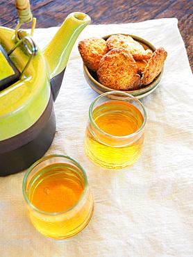 Ginger herbal tea, herbs and homemade organic flour cookies, Umbria, Italy, Europe