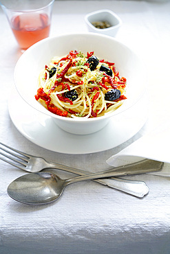 Durum wheat spaghetti pasta seasoned with dried tomatoes, black olives, Pantelleria capers, oregano and extra virgin olive oil, Italy, Europe
