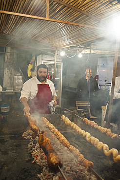 "Porceddu, roast baby pork wrapped around a spit, ""Cordula"" made up of braided and cooked kid or lamb intestines wrapped around a spit, typical Sardinia recipe, Campidano, Sardinia, Italy, Europe"