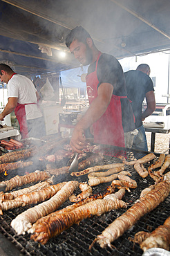 """Cordula"" made up of braided and cooked kid or lamb intestines wrapped around a spit, typical Sardinia recipe, Campidano, Sardinia, Italy, Europe"
