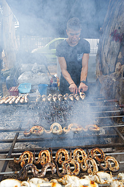 Mullet, Cuttlefish and Eels on the spit, typical Sardinia recipe, Campidano, Sardinia, Italy, Europe