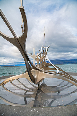 Sun Voyager monument with clouds, landmark of Reykjavik city.