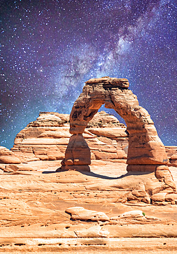 Delicate Arch as seen from lower point of view with milky way at night, Arches National Park, UT.