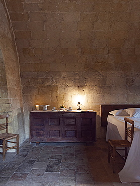 Bedroom of the hotel Le Grotte della Civita located in the Sassi di Matera that represents the almost paradigmatic expression of the Minor Historical Heritage, Matera, Basilicata, Italy, Europe
