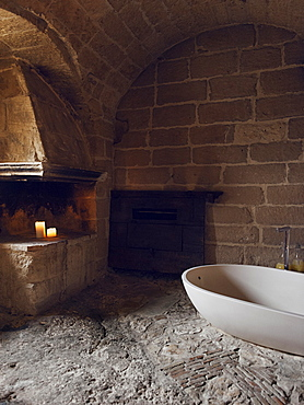 Bathroom built inside bedroom of the hotel Le Grotte della Civita located in the Sassi di Matera that represents the almost paradigmatic expression of the Minor Historical Heritage, Matera, UNESCO World Heritage Site, Basilicata, Italy, Europe