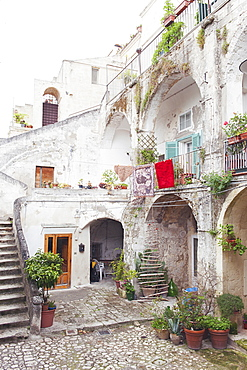 View of a typical open courtyard the historic center of Matera, Basilicata, Italy, Europe